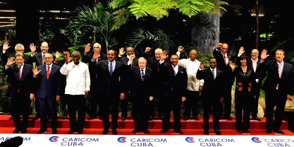 Cuban President Raul Castro (C Front) and leaders attending the 5th Summit of the Caribbean Community (CARICOM) and Cuba pose for a group photo in Havana, Cuba, on Dec. 8, 2014. ...