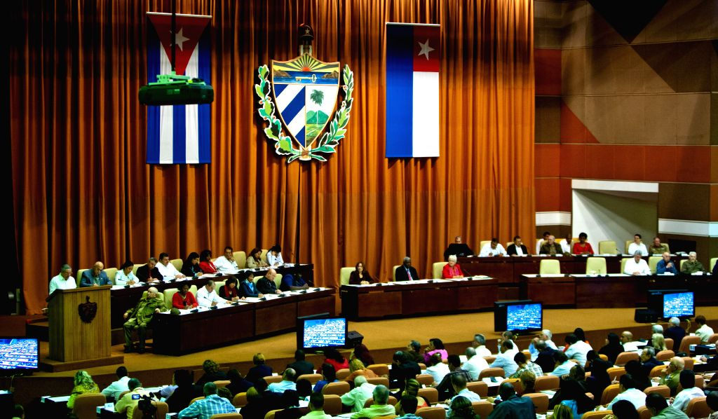 The closing of the twice-yearly meeting of the National Assembly is held in Havana, Cuba, Dec. 20, 2014. Cuban leader Raul Castro told parliament on Saturday that ...