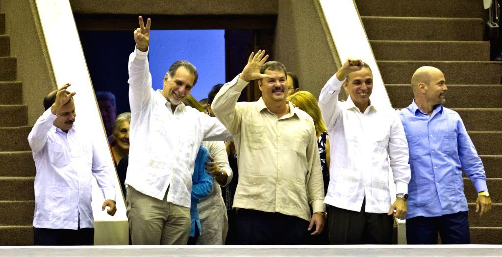 The Cuban Five (L to R), Fernando Gonzalez, Rene Gonzalez, Ramon Labanino, Antonio Guerrero and Gerardo Hernandez gesture during the closing of the twice-yearly ...