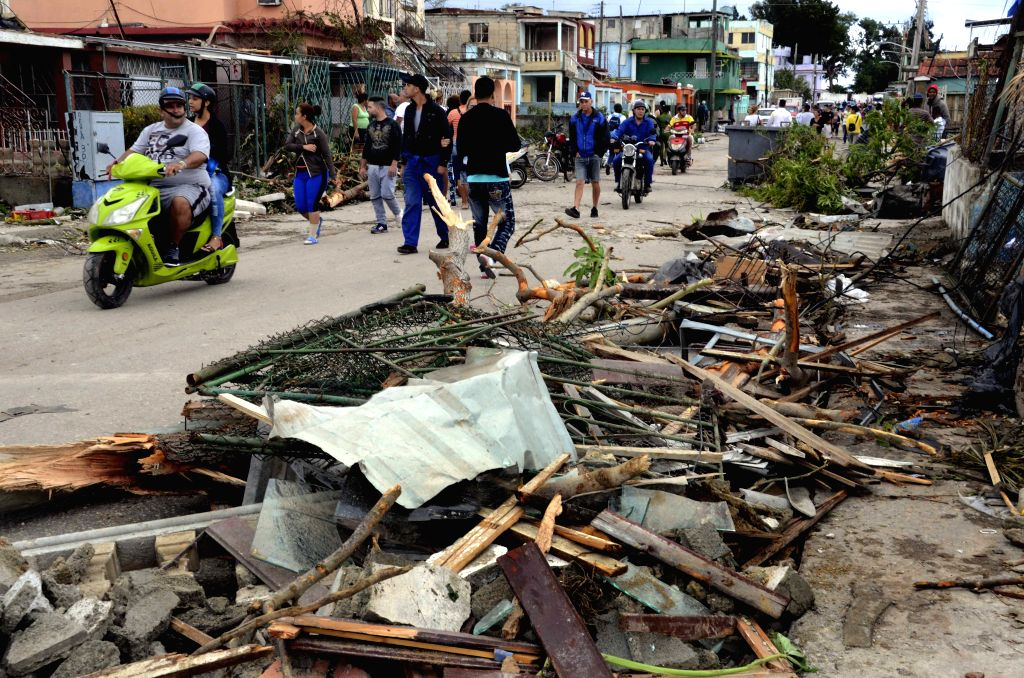 HAVANA, Jan. 29, 2019 (Xinhua) -- People walk past debris in the tornado-affected area in the municipality of Regla in Havana, Cuba, Jan. 28, 2019. A powerful tornado passed through the Cuban capital on Sunday night, leaving three people dead and 172