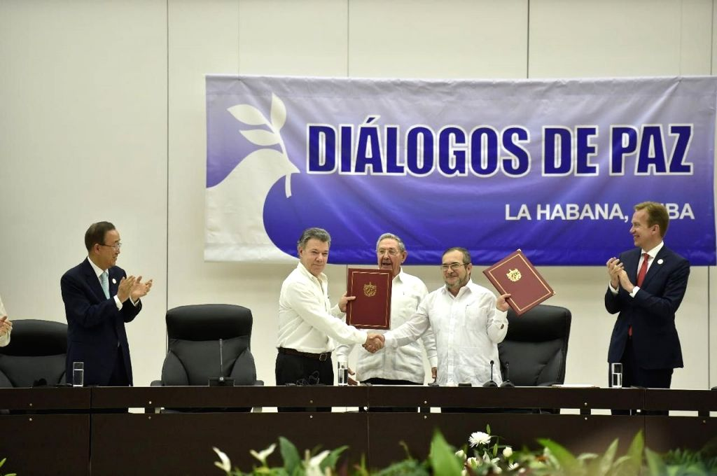HAVANA, June 23, 2016 - Colombian President Juan Manuel Santos (2nd-L) shakes hands with Timoleon Jimenez (2nd-R), the top leader of the Revolutionary Armed Forces of Colombia (FARC) in the signing ...