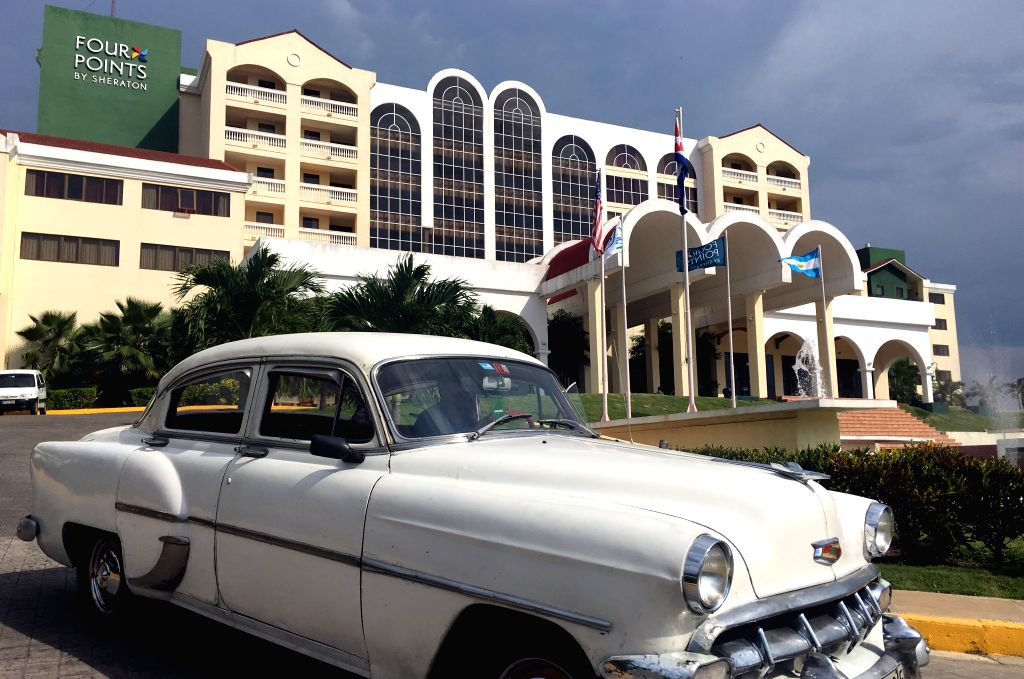 HAVANA, June 29, 2016 - A vintage car passes the Hotel Four Points by Sheraton in Havana, capital of Cuba, on June 29, 2016. U.S. hotel and leisure company Starwood on Tuesday officially started to ...
