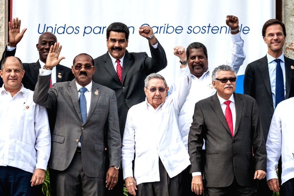HAVANA, June 5, 2016 - Cuban President Raul Castro (front C) poses for group photos with guests during the opening ceremony of a summit of the Association of Caribbean States (ACS) in Havana, capital ...