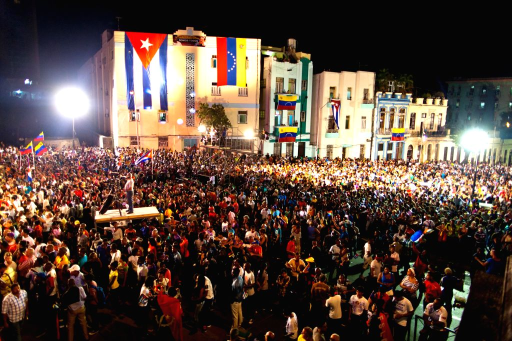 Thousands of Cubans rally to support Venezuela in a mounting row with the U.S. at Havana University in Havana, Cuba, March 15, 2015. Cuban government confirmed its ...