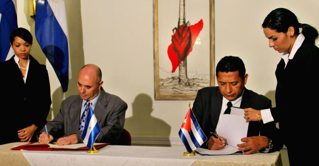 President of the Institute of Civil Aeronautics of Cuba Alfredo Pablo Cordero (2nd L) and the Director General of the Nicaraguan Institute of Civil Aeronautics ...