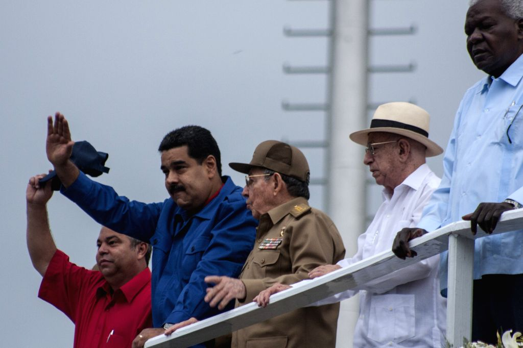 Cuba's President Raul Castro (C), his Venezuelan counterpart Nicolas Maduro (2-L), and Cuban vice president Jose Ramon Machado Ventura (R), watch a May Day parade at ...