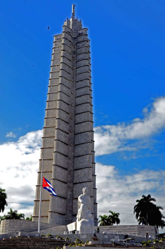 HAVANA, Nov. 27, 2016 - A Cuban national flag flies at half-mast in front of the memorial to Jose Marti after the death of the leader of the Cuban revolution, Fidel Castro, at the Square of ...