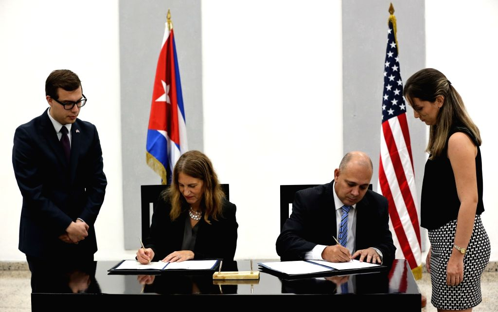 HAVANA, Oct. 21, 2016 - Cuban Public Health Minister Roberto Morales (2nd-R) and U.S. Secretary of Health and Human Services Sylvia Burwell (2nd-L) sign a memorandum of understanding, in Havana, ... - Roberto Morales