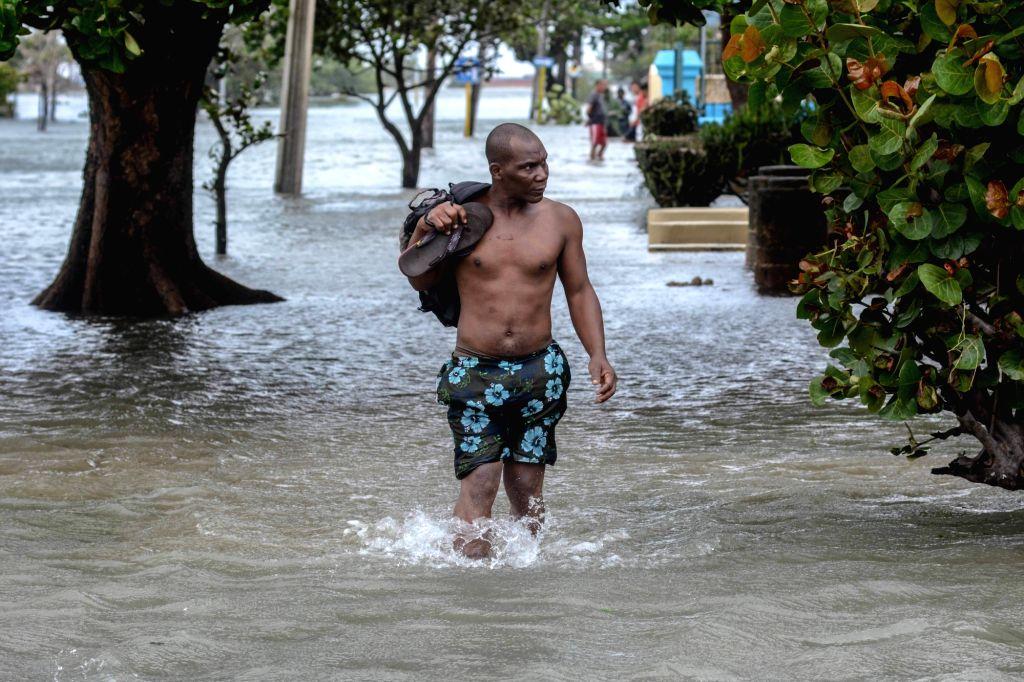 HAVANA, Sept. 11, 2017 - A man walks through a flooded street after the passage of Hurricane Irma, in Havana, Cuba, on Sept. 10, 2017.