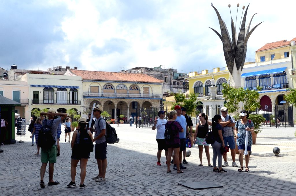 HAVANA, Sept. 11, 2018 - Tourists visit the Old Square in Havana, capital of Cuba, Sept. 7, 2018. Cuba's tourism industry is preparing for the year-end high season.