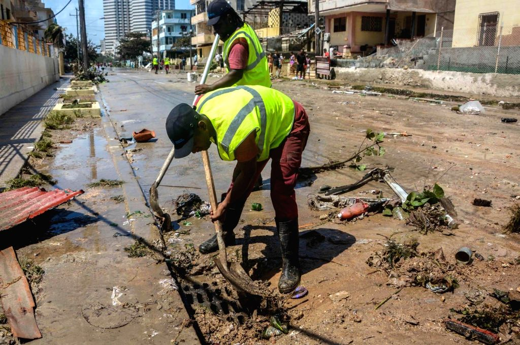 HAVANA, Sept. 12, 2017 - People take part in the recovery and cleaning work after the pass of hurricane Irma in Havana Sept. 11, 2017.