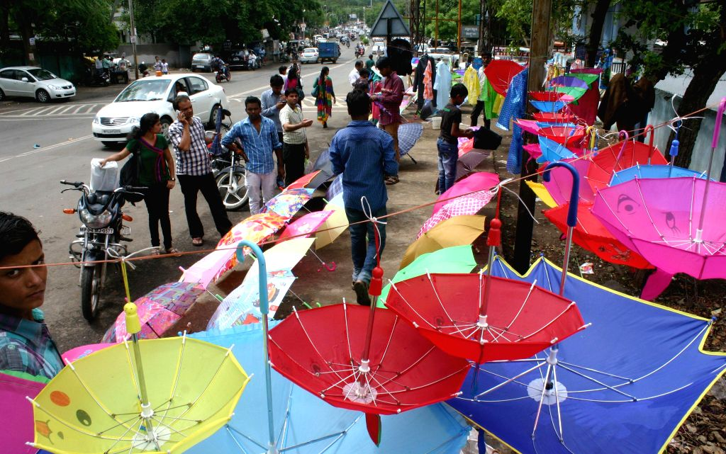 Hawkers sell umbrellas on the sidewalks of Bhopal on July 18, 2014.