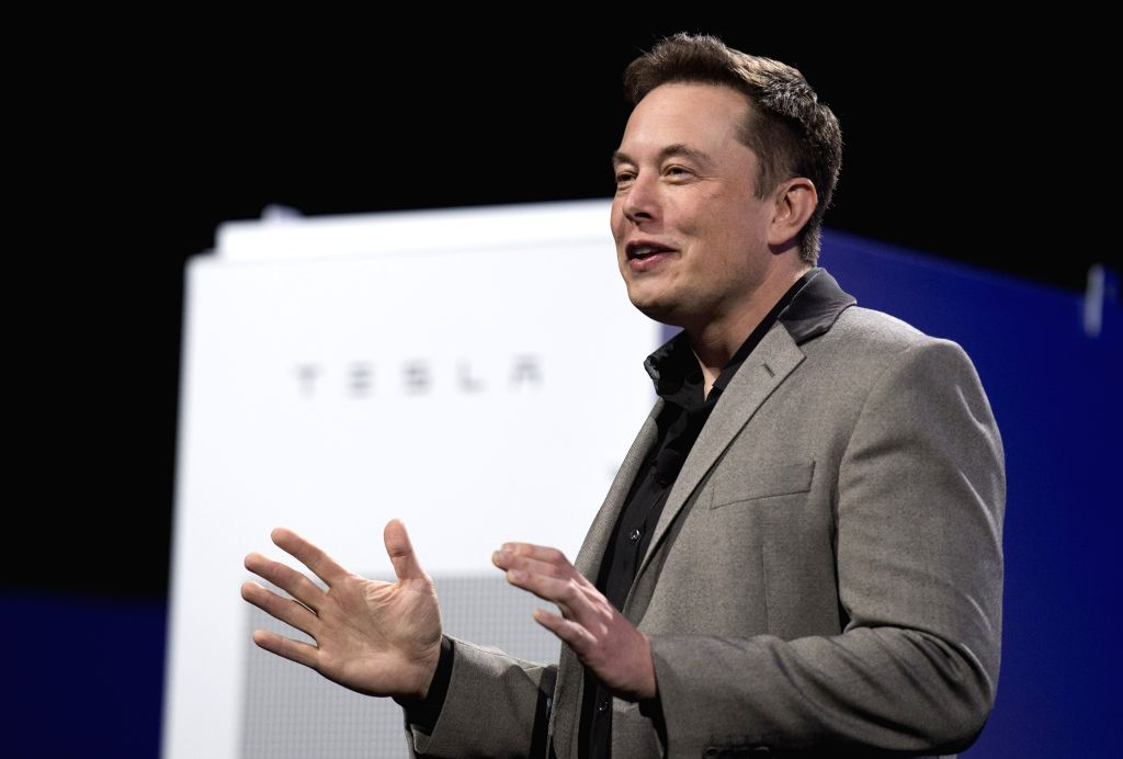 Elon Musk, CEO of Tesla, unveils a suit of batteries for homes, businesses, and utilities at Tesla Design Studio in Hawthorne, California, the United States, April ...