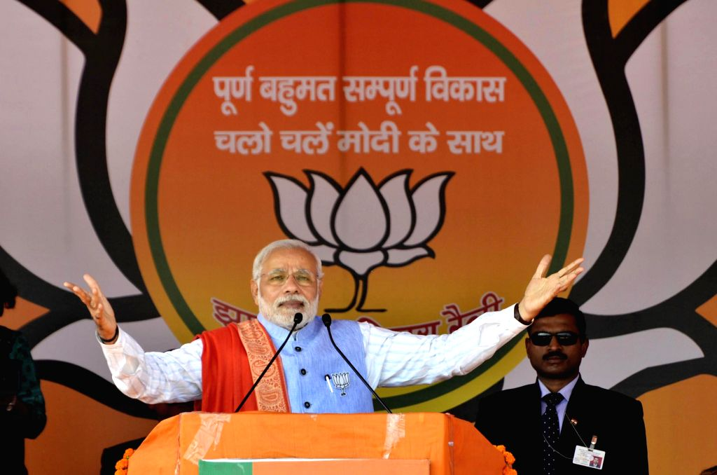 Prime Minister Narendra Modi addresses during an election rally ahead of third phase of Jharkhand assembly elections at Hazaribagh, Jharkhand on Dec. 6, 2014. - Narendra Modi