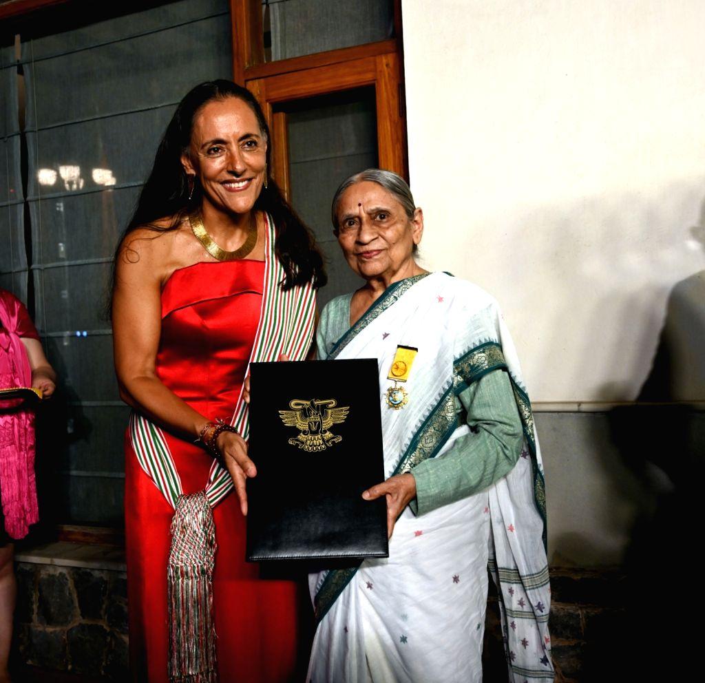 HE, Ms. Melba Pría, Ambassador of Mexico to India presenting the prestigious award 'The Order of the Aztec Eagle' to Ela Bhatt, founder of SEWA, the Self-Employed Women's Association of ...