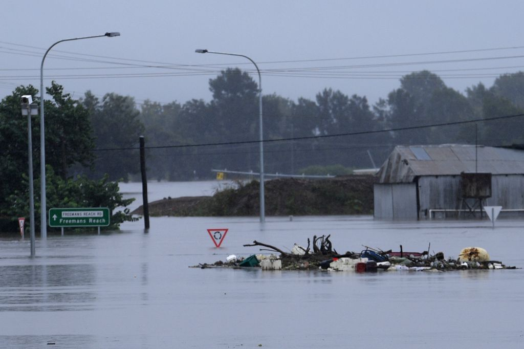 he New Windsor Bridge is seen inundated by flood waters from the Nepean River at Windsor in the north west of Sydney, Monday, March 22, 2021. Thousands of residents are fleeing their homes, schools are shut, and scores of people have been rescued as