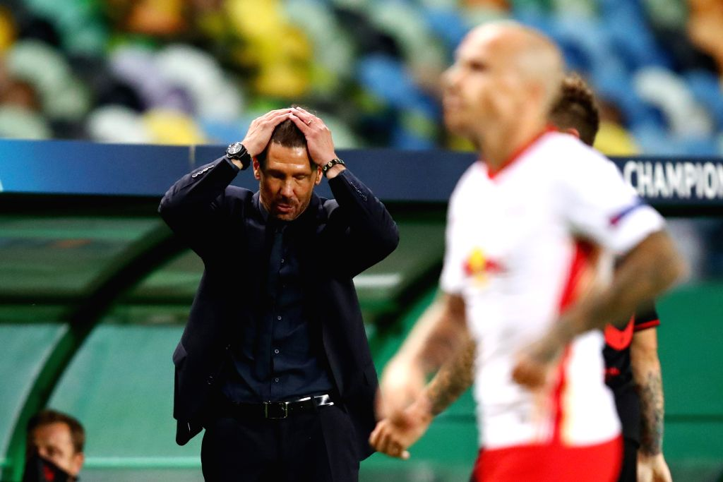 Head Coach of Atletico Madrid Diego Simeone (L) looks dejected during the 2019-2020 UEFA Champions League quarter final match between RB Leipzig and Atletico Madrid ...