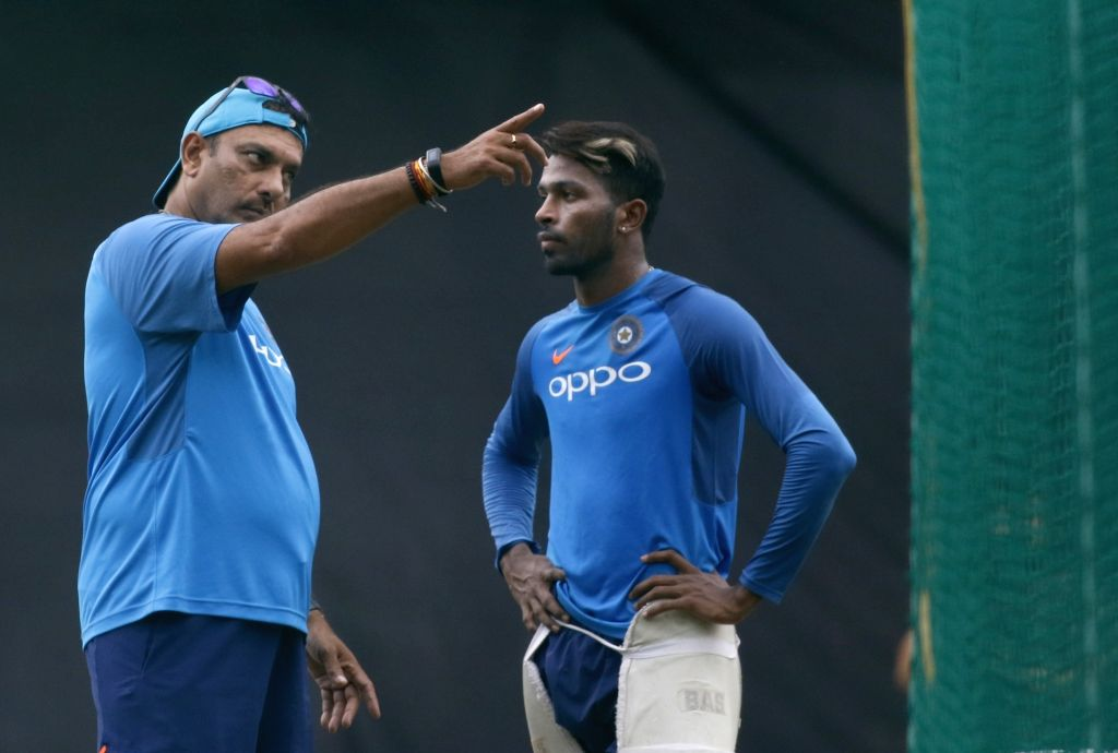 Head Coach of India Ravi Shastri and Hardik Pandya during a practice session ahead of the 3rd T20 match against Australia at the Rajiv Gandhi International Cricket Stadium in Hyderabad on ...