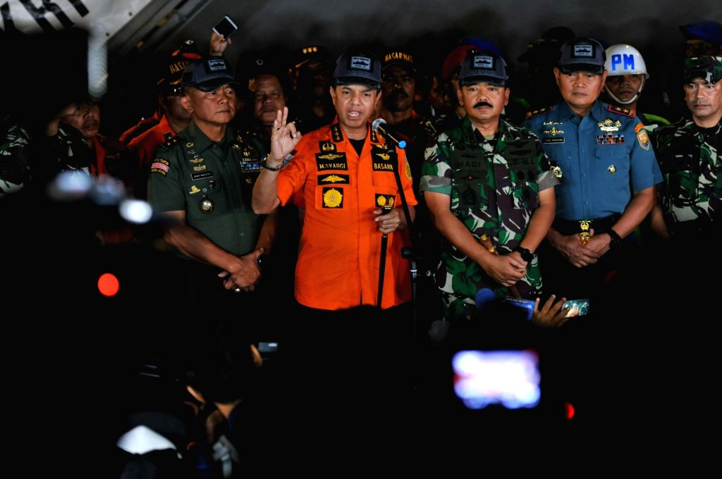 :Head of the Indonesian national search and rescue office Muhammad Syaugi (C) speaks during a press conference at the Tanjung Priok port, Jakarta, Indonesia, Oct. ...