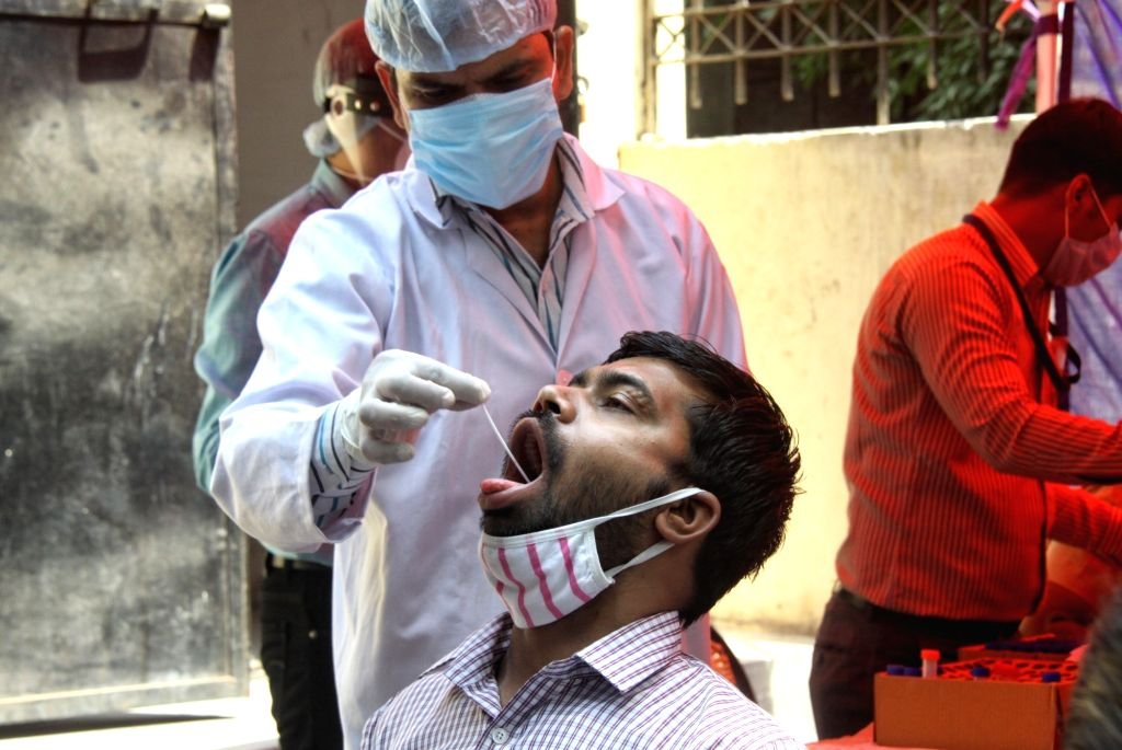 Health worker collect swab sample for Covid-19 testing at South MCD Dispensary,  Jung Pura in new Delhi on Friday April 16, 2021.