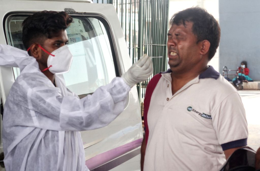 Health worker collect swab sample for Covid-19 testing at Shastri park in New Delhi on Tuesday June 08, 2021.