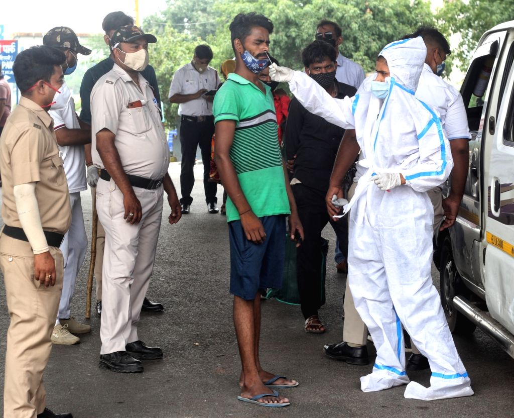 Health worker collect swab sample for Covid-19 testing at Shastri park in New Delhi on Sunday June 13, 2021.