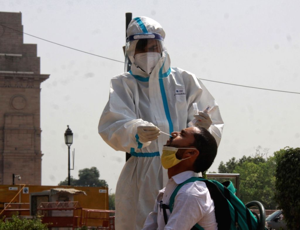 Health worker collects swab sample testing for Covid-19 at India Gate in new Delhi on Saturday March 27, 2021.