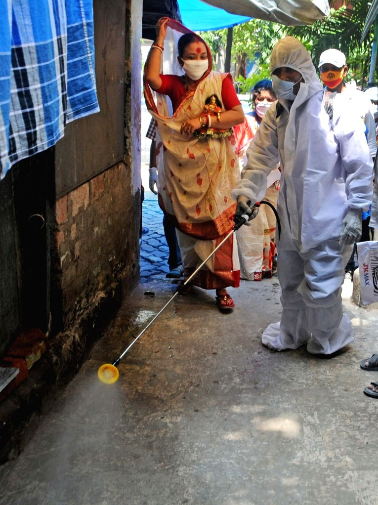 Health worker wearing a PPE suite spray disinfectant at Beliaghata amid COVID-19 coronavirus, in Kolkata on Aug 30, 2020.