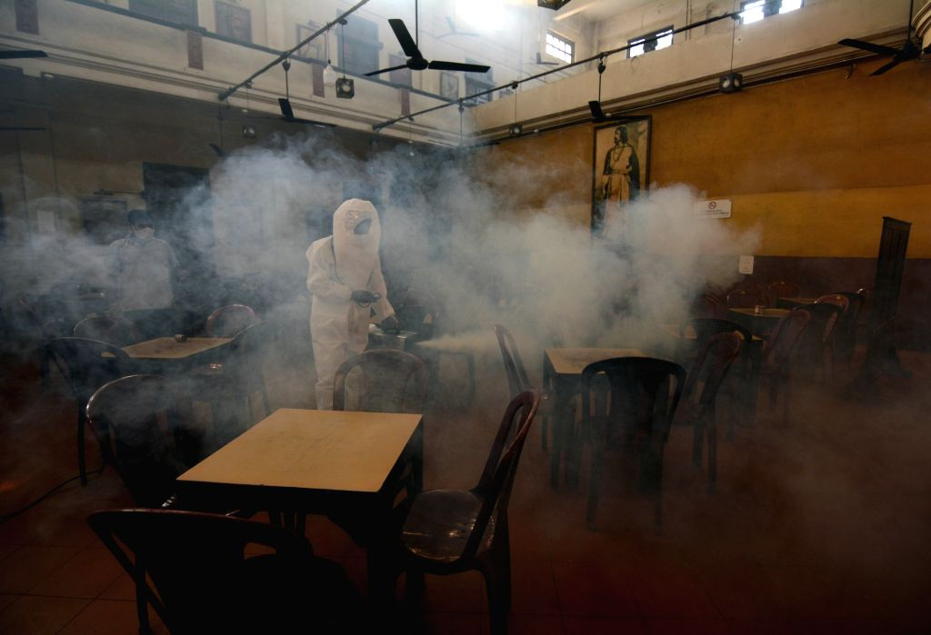 Health worker wearing PPE kit senitized Coffee House before its re-open, after authority restricted permissions of Covid 19 situations in Kolkata on Wednesday 09 June, 2021.
