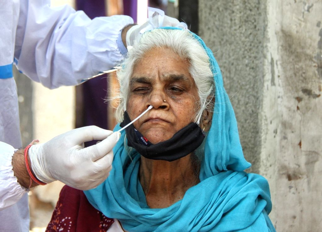 Health worker wearing PPE suits and collect swab sample for Covid-19 testing at South MCD Dispensary Jangpura in new Delhi on Tuesday April 13th, 2021.