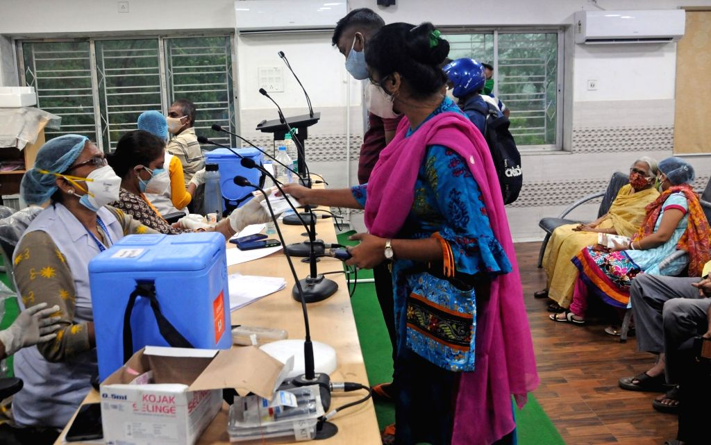 Health workers are giving the Covishield vaccine to the Bidhannagar Municipal Corporation workers during increasing numbers of COVID 19 cases at Salt Lake in Kolkata on 11 May, 2021.