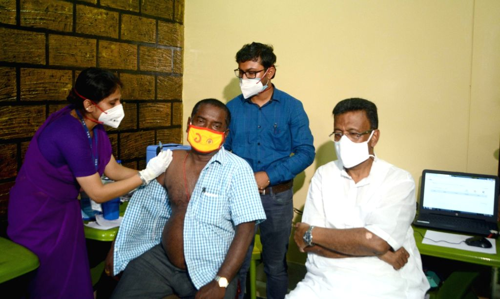 Health workers are giving the vaccine to the Transport workers during increasing numbers of COVID 19 cases in Kolkata on 11 May, 2021.