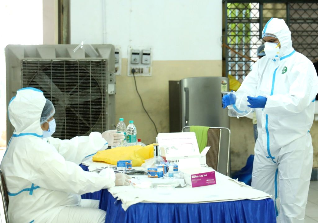 Health workers at a coronavirus testing centre set up at a Government school in Delhi's Karol Bagh on June 23, 2020.