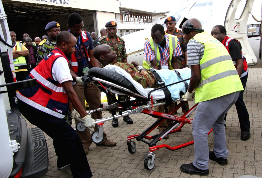 Health workers carry an injured soldier to an ambulence at Wilson Airport in Nairobi, Kenya, on Jan. 17, 2016. The Kenyan government has started evacuating its ...