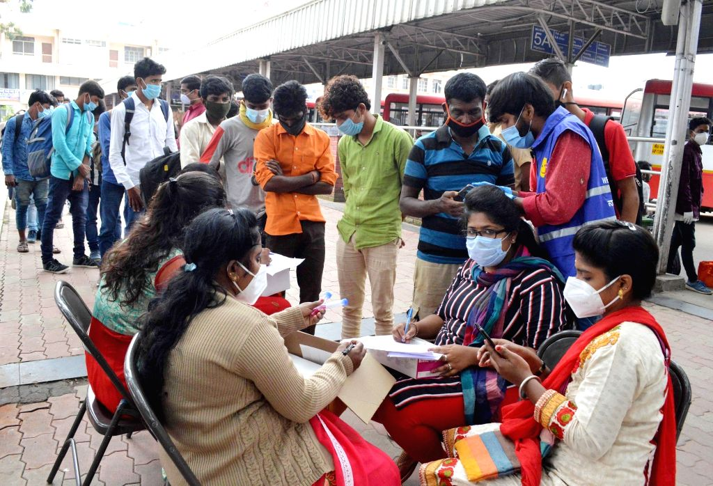 Health workers collect samples for COVID-19 testing, at Bengaluru Central Railway Station on Oct 20, 2020.