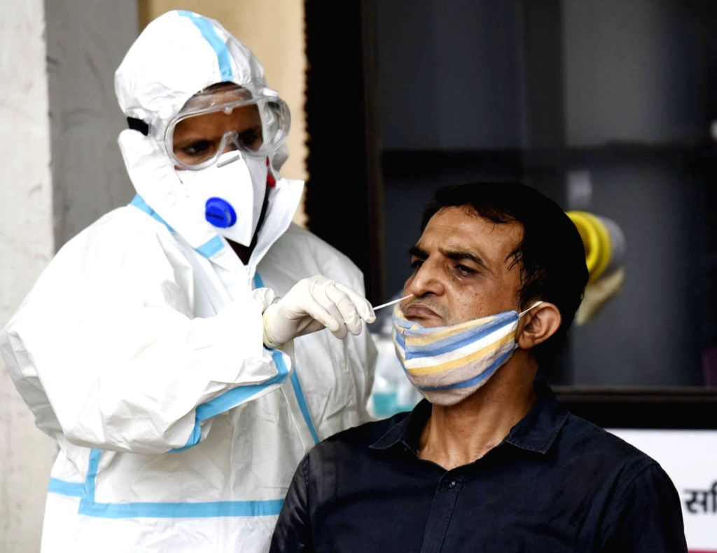 Health workers collect swab samples at New Gardiner Hospital wearing PPE kits amid ongoing pandemic, in Patna on August 30, 2020.