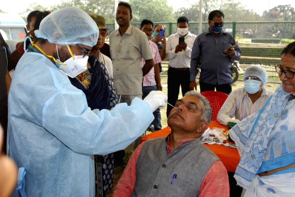 Health workers collected swab from BJP leaders for COVID 19 test at Brigade Parade Ground on the eve of Prime Minister Narendra Modi's rally at Brigade Parade Ground in Kolkata on Saturday ... - Narendra Modi