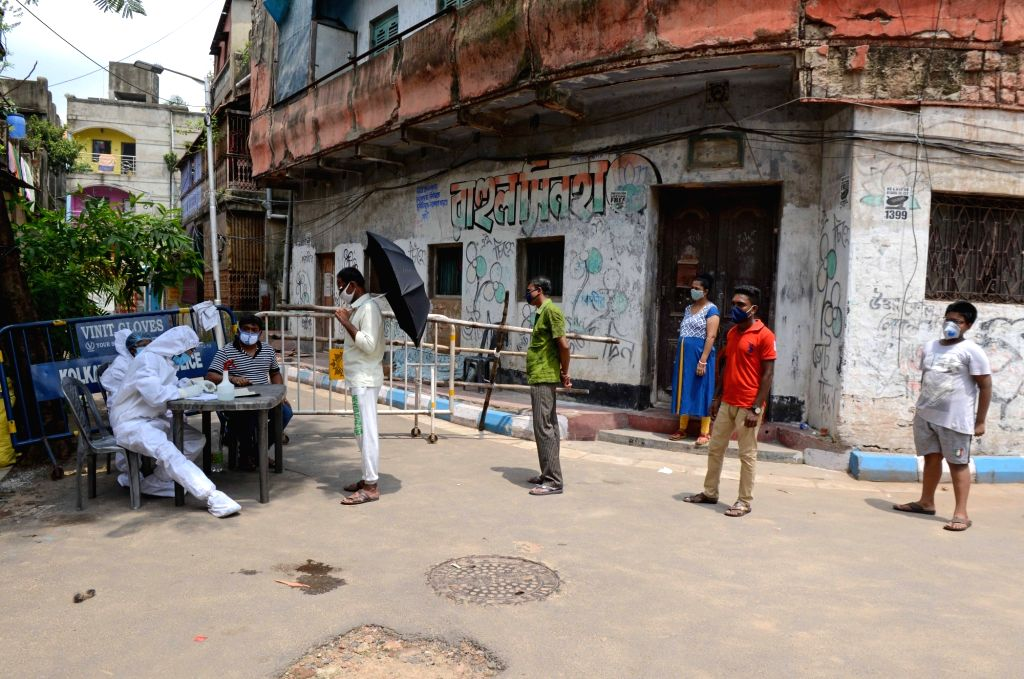 Health workers conduct COVID-19 screening on the locals of a coronavirus containment zone, in Kolkata on July 9, 2020. The Mamata Banerjee-led West Bengal government has imposed complete ... - The Mamata Banerjee