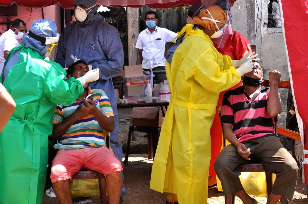 Health workers conduct polymerase chain reaction (PCR) tests for COVID-19 for people at Manning Market in Fort area of Colombo, Sri Lanka, Aug. 28, 2020. Sri Lanka ...
