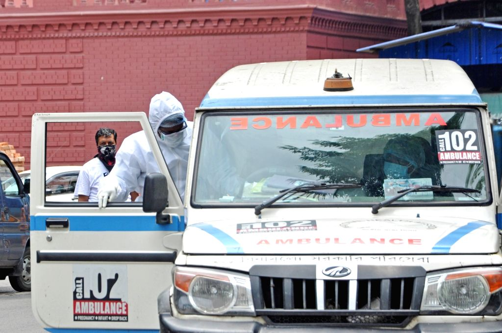 Health workers engaged in their work wearing Personal Protective Equipment (PPE) suits at Kolkata's SSKM College and Hospital during the extended nationwide lockdown imposed to mitigate the ...