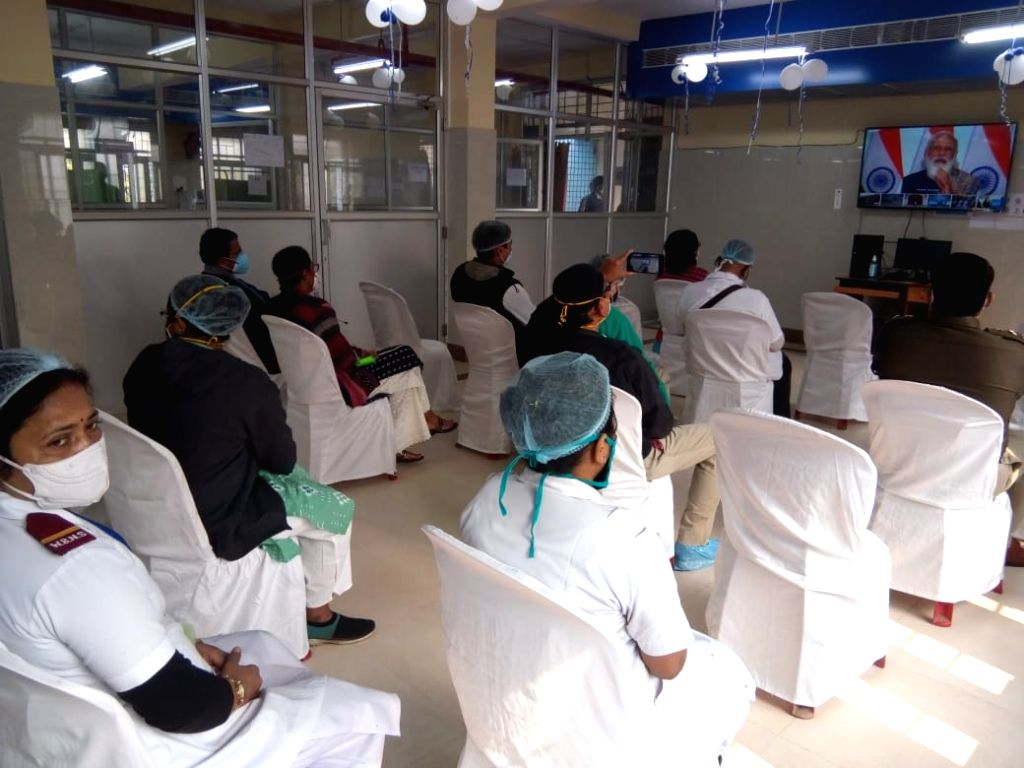 Health Workers watching PM Narendra Modi live  before covid-19 vaccination drive at Salt Lake subdivision hospital in Kolkata on January 16, 2021 - Narendra Modi