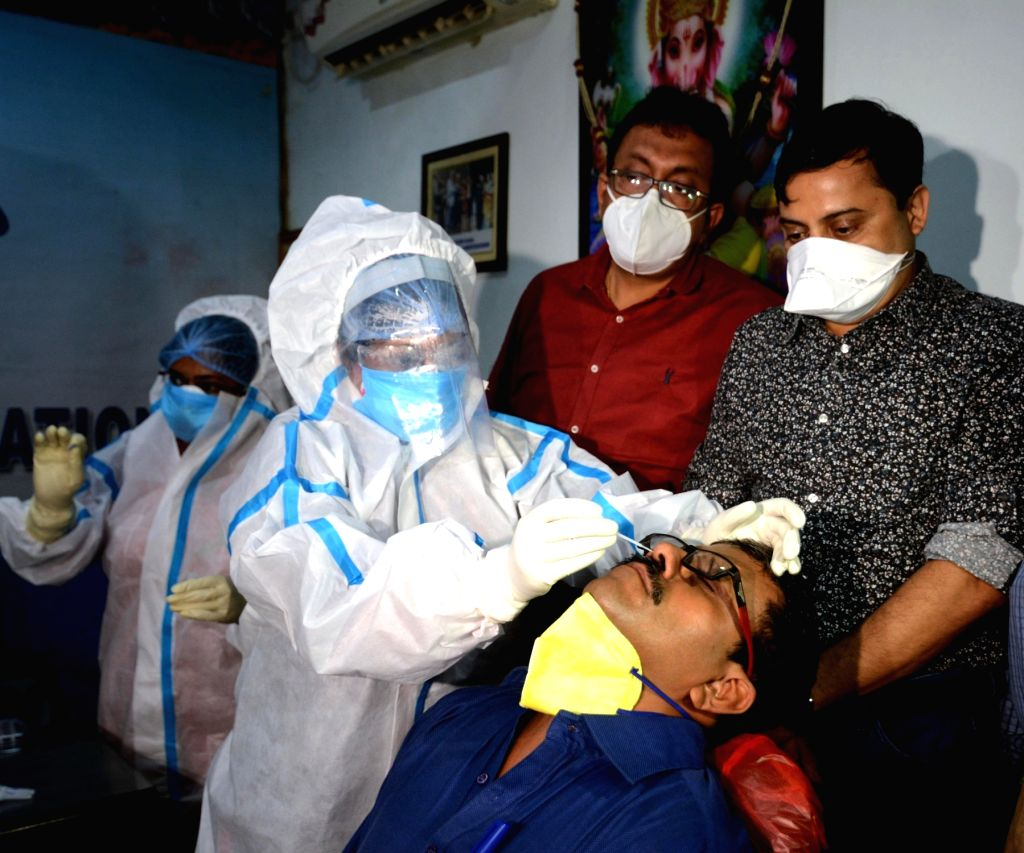 Health workers wearing PPE suits collect samples from people and even Doctors for COVID 19 rapid antigen test organised by Indian Medical Association in Kolkata on August 30, 2020.