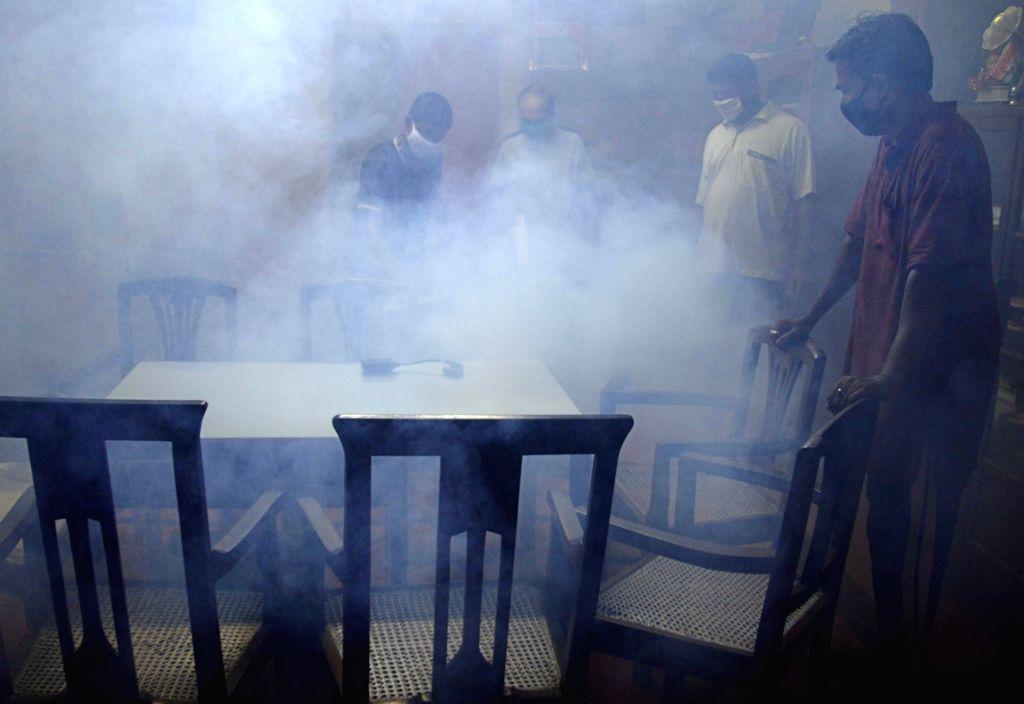 Health workers wearing PPE suits sanitized rooms at Sree Ramakrishna Ananda Ashram Children Home during the Coronavirus pandemic in Kolkata on Sunday, May 16, 2021.