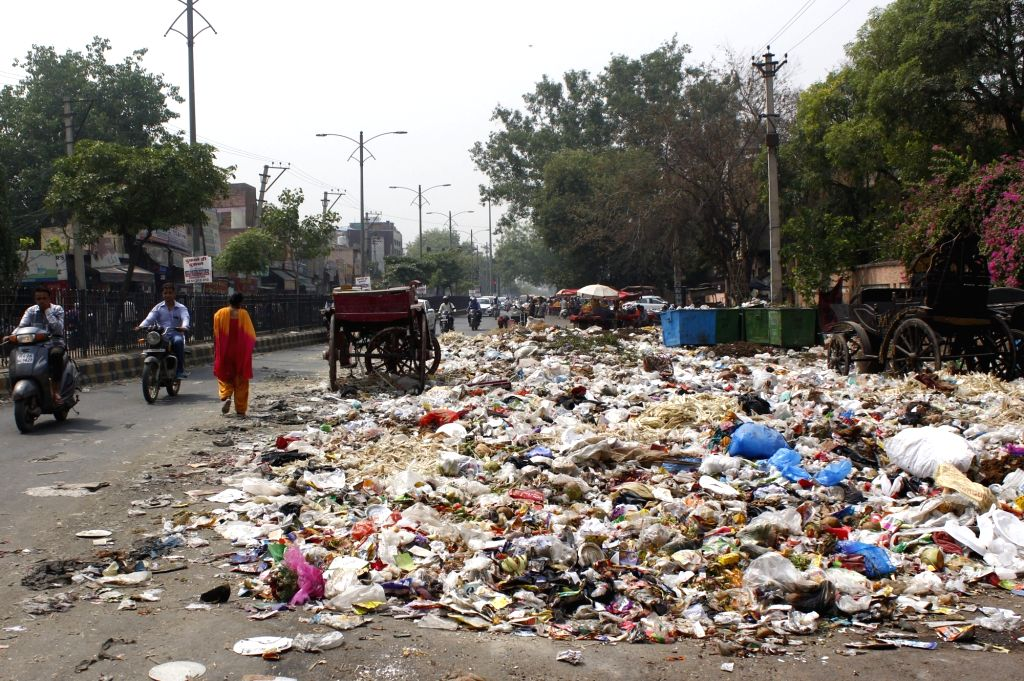 Heap of garbage piles up on a street as the strike by municipal sanitation staff in Haryana entered the 16th day; in Gurugram on May 24, 2018.