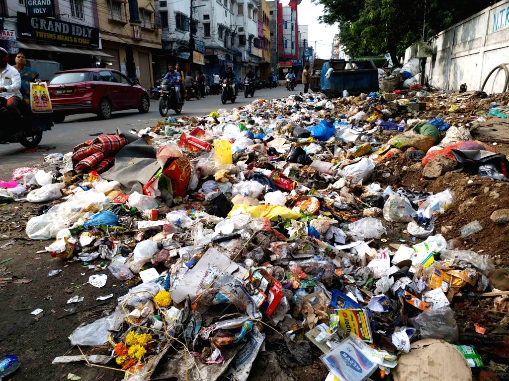 Heaps of garbage lies uncleaned at a roadside after Dussehra celebrations, in Hyderabad on Oct 10, 2019.
