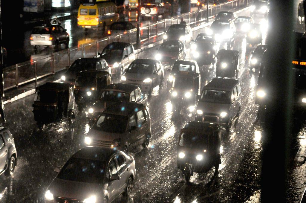 Heavy rains lashes New Delhi on May 23, 2016.