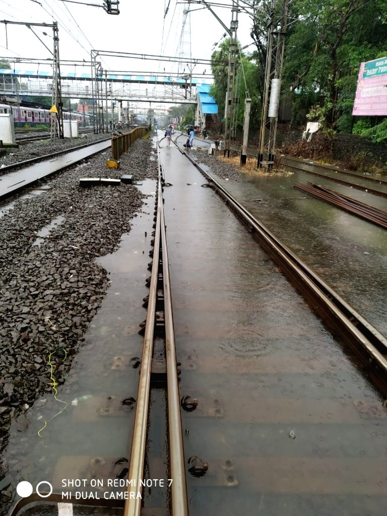 Heavy rains leave railway tracks flooded, in Mumbai on Sep 4, 2019. The Western Railway (WR) had to suspended suburban and long distance services on the Vasai-Virar sector (Palghar) after ...