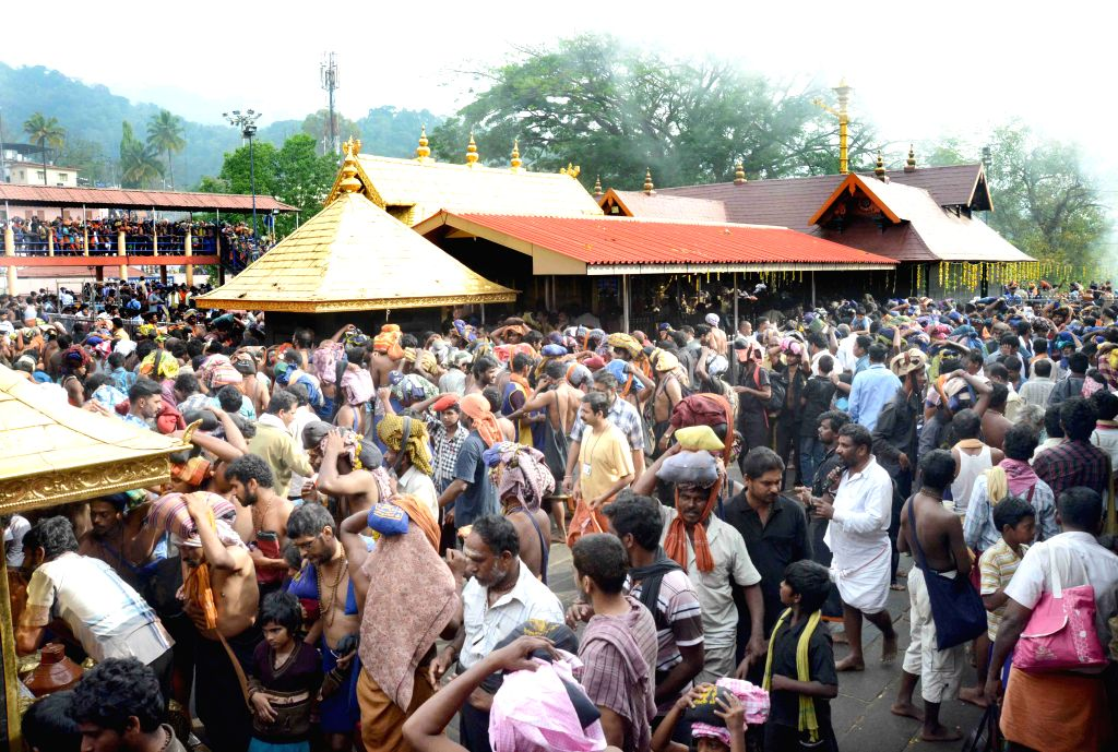 : Heavy rush at Sabarimala at Sannidanam Valiya Nadapanthal on Mandalapooja day in Kerala. (Photo: IANS).