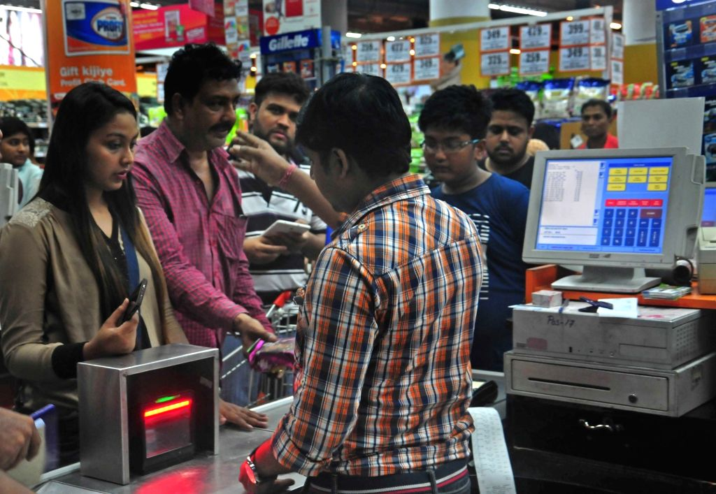 Heavy rush of shoppers at a supermarket after Goods and Services Tax (GST) roll out in Kolkata on July 1, 2017.