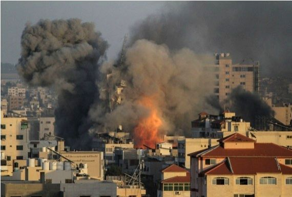 Heavy smoke rises following an Israeli air strike in central Gaza City, on May 12, 2021.
